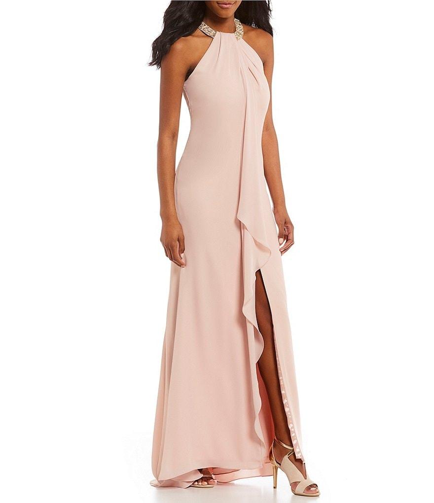 Shoptagr | Slit Ruffle Front Beaded Halter Gown by Calvin Klein