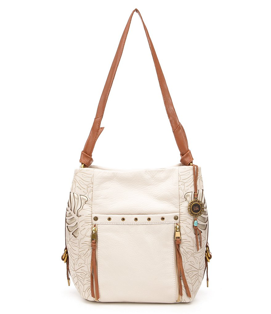 The Sak Ojai Leaf Cutout Tasseled Bucket Bag