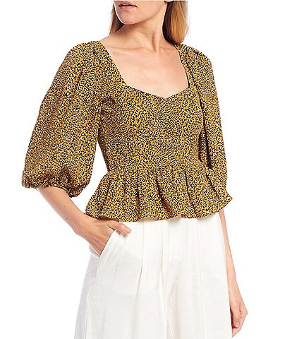 Evolutionary Puff Sleeve Tie Back Animal-Printed Peplum Top