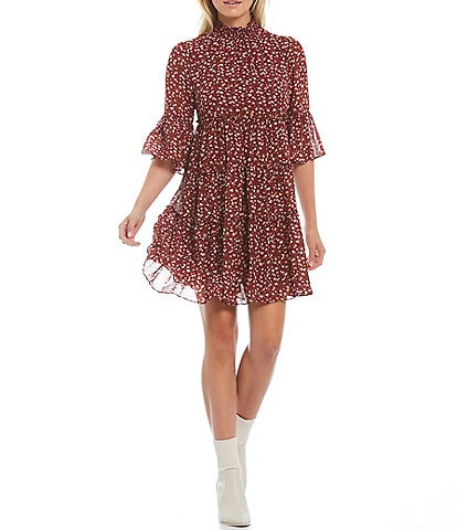 Skies Are Blue Ditsy Floral Print Smocked Mock Neck Ruffle Elbow Short Sleeve Tiered Babydoll Mini Dress